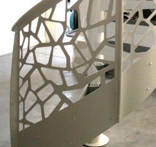 balustrada metalica ornamentala la o scara interioara forma eliptica cu trepte in spirala