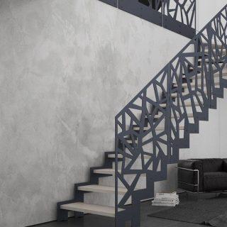 scara metalica interioara moderna cu balustrada decorativa din otel