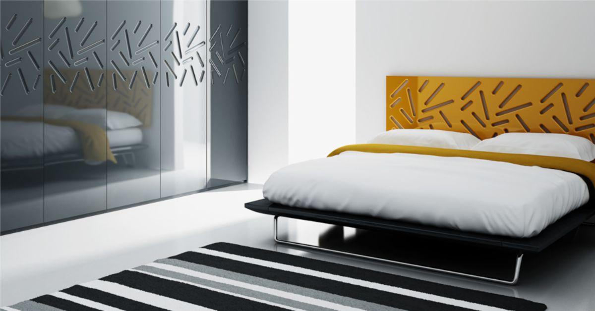 imagine dormitor mic cu tablia de pat si fronturi usa sifonier avand decupaje liniare